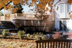 FALLING WATER: Wall, patio, trellis, ponds and plants
