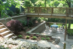 A GRADE ABOVE: Garage, Walls, Decks, Plantings