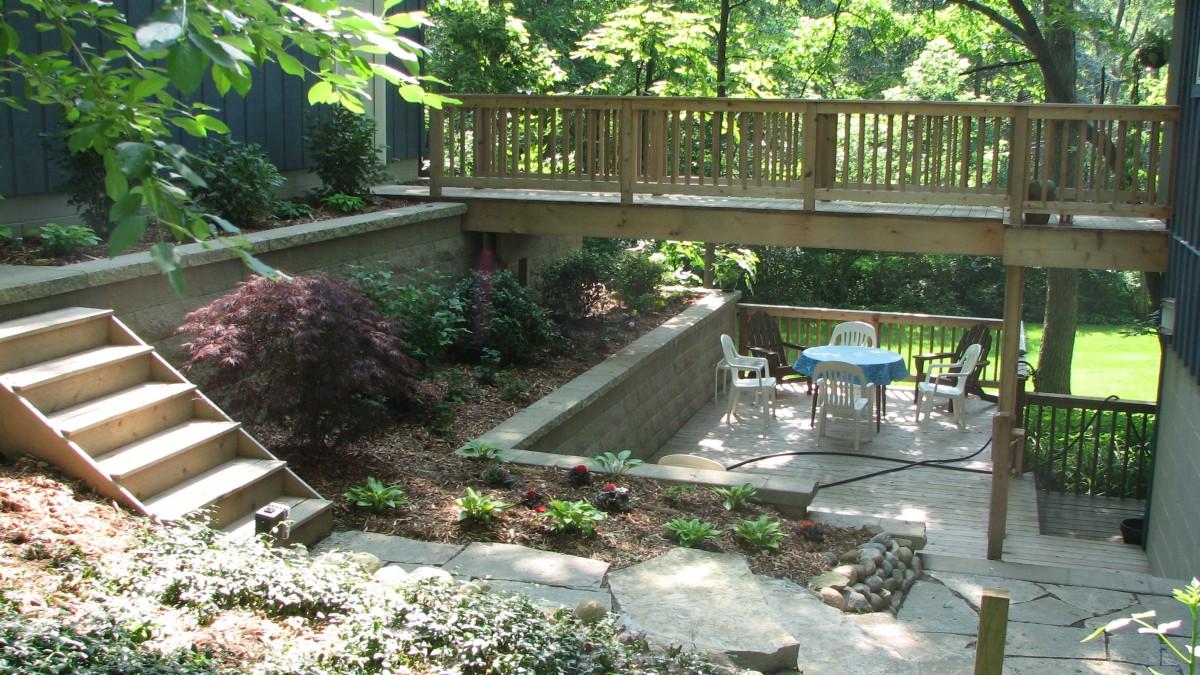 A GRADE ABOVE Garage Walls Decks Plantings Turners